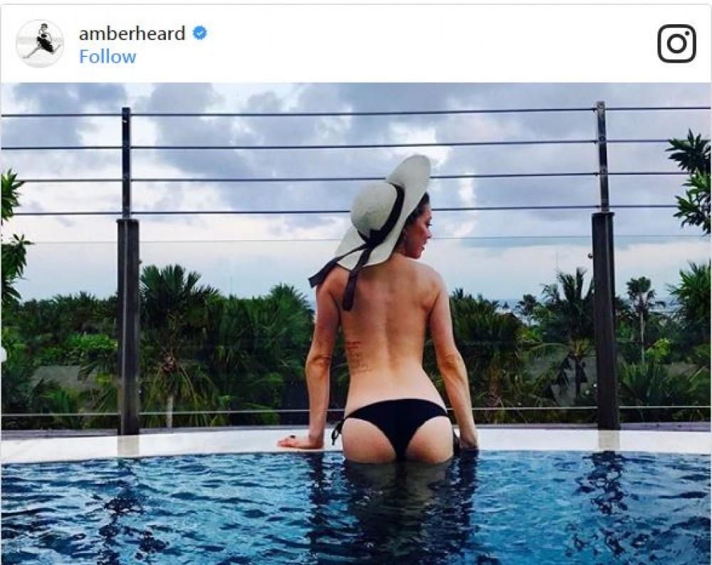 Amber Heard Topless amber heard in bali and her topless pictures have people
