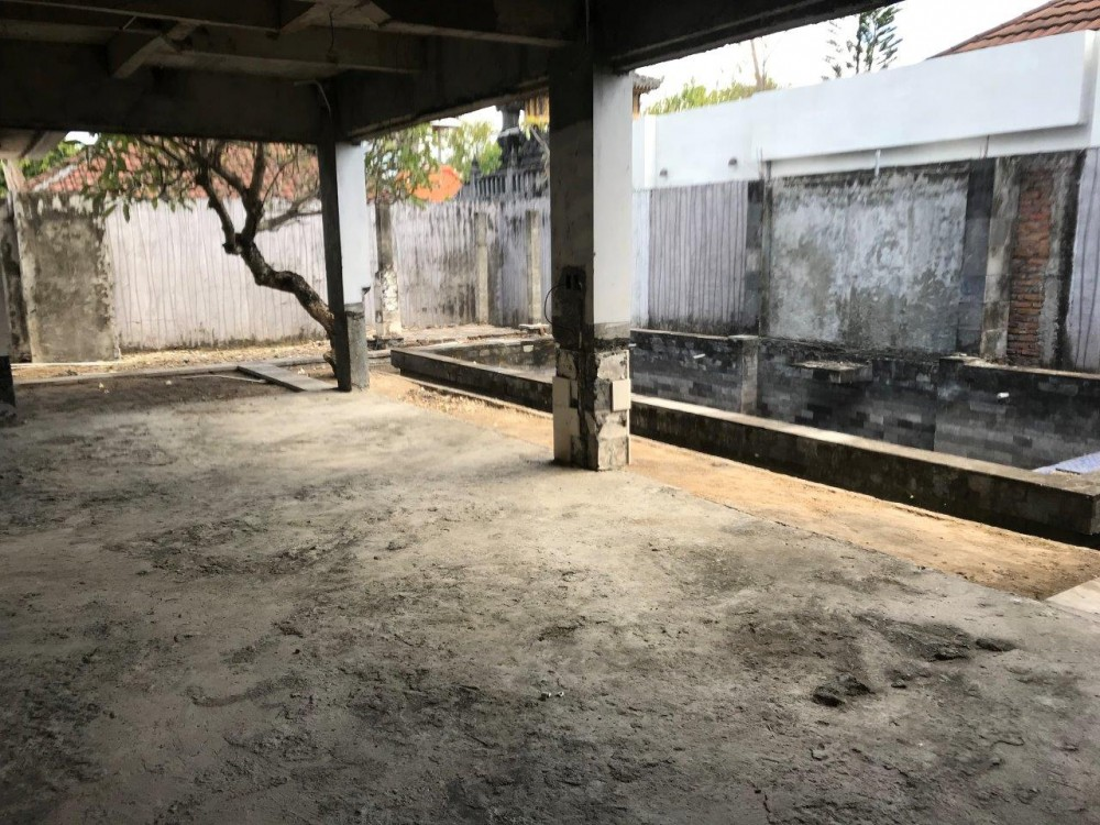 Land with construction for sale near the beach