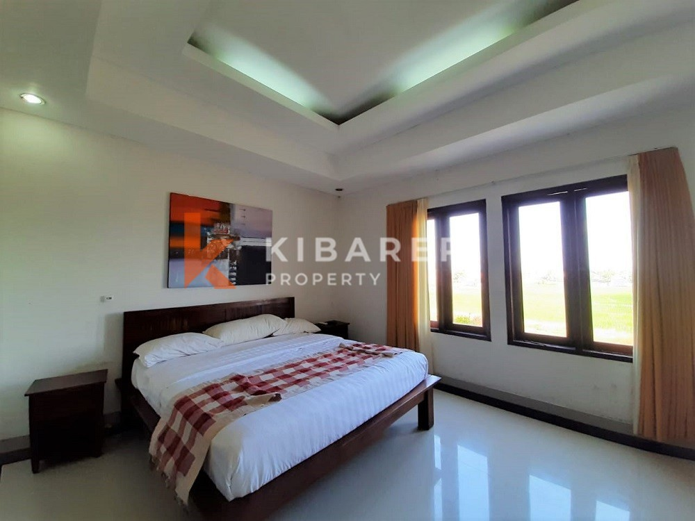 Cozy Two Bedroom Villa semi furnished with rice field view in Cemagi
